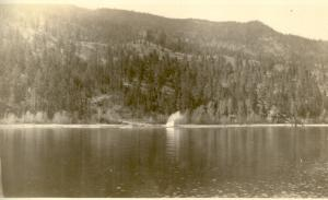 Early logging chute, possibly near Wilson's Landing on Okanagan Lake.